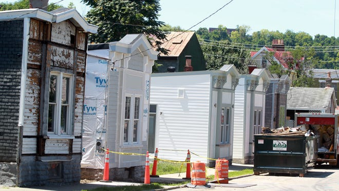 The exterior of the five houses on Orchard Street in Covington being renovated by the Center for Great Neighborhoods.