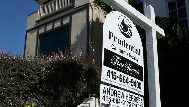 A realtor sign is shown in front of a home for sale in San Francisco.