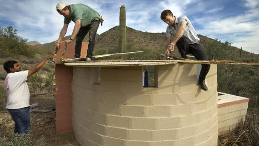 """The Frank Lloyd Wright School of Architecture embraces the """"learning by doing"""" philosophy of Wright. Students are show this spring redesigning the """"Lotus Shelter"""" first erected at Taliesin West in Scottsdale in 1963."""