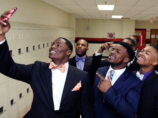 Pearl-Cohn football players Koreyon Jordan, from left,  Ke'Shawn Vaughn and Mario Gordon pose for a selfies in the school hallway before going to their signing day ceremony on Feb. 4.