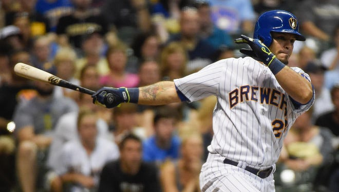 Milwaukee Brewers left fielder Gerardo Parra (28) drives in a run with a base hit in the seventh inning against the Pittsburgh Pirates at Miller Park.