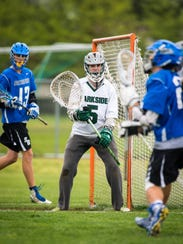 Parkside goalkeeper Phil Gianelle (5) guards the cage