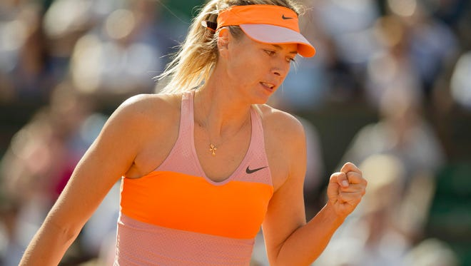 Maria Sharapova (RUS) reacts during her match against Eugenie Bouchard (CAN) on Day 12 at the 2014 French Open at Roland Garros.