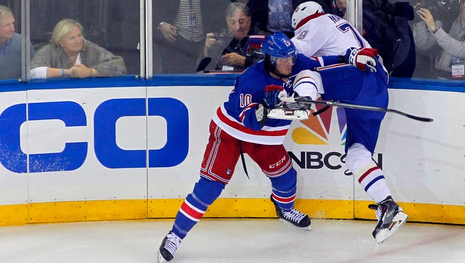 Montreal Canadiens defenseman Andrei Markov, right, is checked by Rangers center J.T. Miller during Game 4 of the Eastern Conference final.