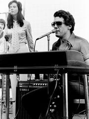 "Jerry Lee Lewis, know as ""The Killer,"" helps to keep things jumping with an hour of bogeying music during the jumping and stunt event at Nashville Speedway Sept. 1, 1975."