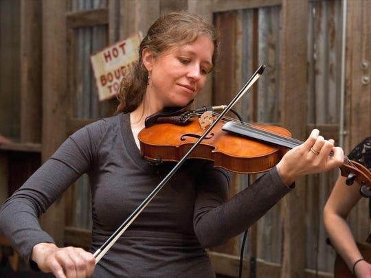 Violin maker Anya Burgess and Kinga Augustyn, a guest
