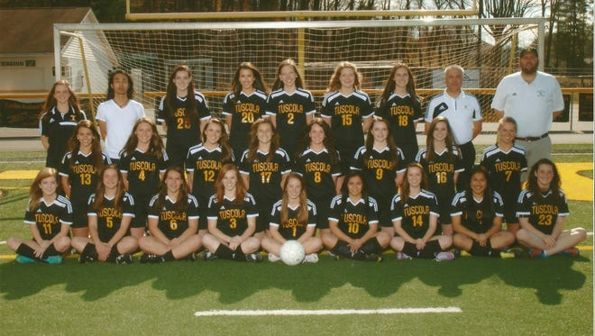 Tuscola's girls soccer team.   Pictured are front row left to right:   Kelly Parkins, Andie Reinmann, Caroline Cox, Malloree Burgin, Cassidy Pate- Moore, Hilda Rios, Taryn Thompson, Jessica Martin, Rachel Swaim.   Second Row:   Mary Rachel Carter, Lizzie Darguzas, Abby Coulter, Ashley Weidlich, Taylor Ross, Molly Escaravage, Sierra DiIenno, Kelly Mimms   Third Row:   Asst Coach Megan Smith, Asst Coach Ku Khang, Alexa McCall, Andrea Deconnick, Sydney McDowell, Shannon Switch, Sydney Turner, Asst Coach Doug Adams, Head Coach Erik Melville