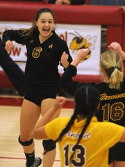 Oxnard High's Peyton Quintana celebrates after making a kill in the second game of their CIF Div. 4 playoff match against Bishop Montgomery at Oxnard Tuesday night.