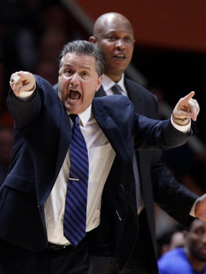 Kentucky head coach John Calipari yells to his players during the first half of an NCAA college basketball game against Tennessee on Tuesday, Feb. 2, 2016, in Knoxville, Tenn. (AP Photo/Wade Payne)