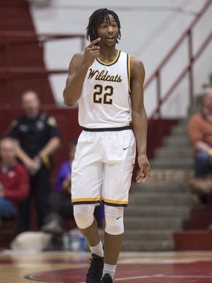 South Bend Riley High School senior Damezi Anderson Jr. (22) talks to one of his teammates during a break in the first half a varsity basketball game at Southport High School, Saturday, December 9, 2017. Southport hosted the Tip-Off Classic tournament through the weekend.