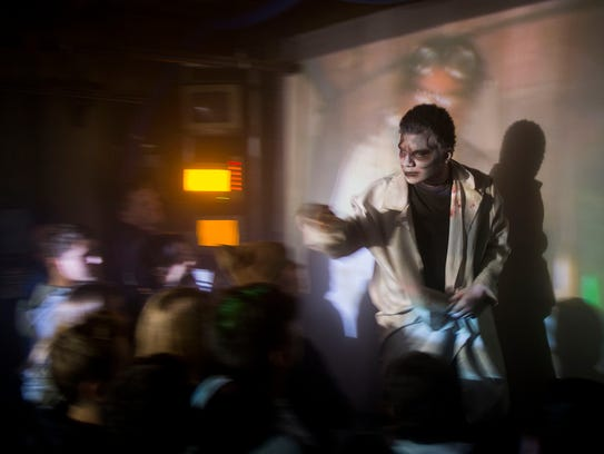 An actor greets the visitors of the Erebus Haunted