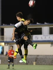 Bank of Guam Strykers D2's James Lee goes airborne to challenge NAPA Rovers' Eddie Lee Lorenzo for a header following a corner kick play in a Round 1 match of the Bank of Guam 10th Annual GFA Cup men's soccer tournament Tuesday May 2, 2017, at the Guam Football Association National Training Center. The Rovers won 9-1.
