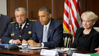 President Obama with Philadelphia Police Commissioner Charles Ramsey and George Mason University Criminology Professor  Laurie Robinson announcing a policing task force Dec. 1.