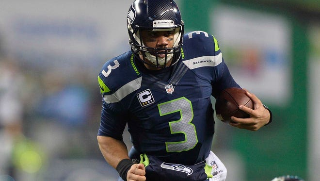 Seahawks QB Russell Wilson beat the Panthers with his arm and legs Saturday.