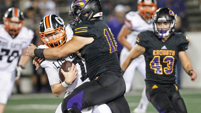 Salinas' Nathan Martorella sacks Los Gatos' Dillon Whitfield during a Central Coast Section: Open Division I semi-finals playoff football game between the Salinas Cowboys and the Los Gatos Wildcats at the Pit at Salinas High School on Friday, November 24, 2017 in Salinas, Calif. Vernon McKnight/for The Californian