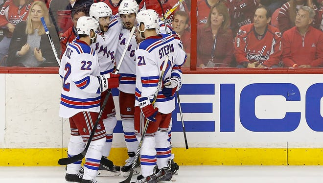 New York Rangers left wing Chris Kreider celebrates with teammates after scoring a goal against the Washington Capitals in the first period in game six of the second round of the Stanley Cup Playoffs.