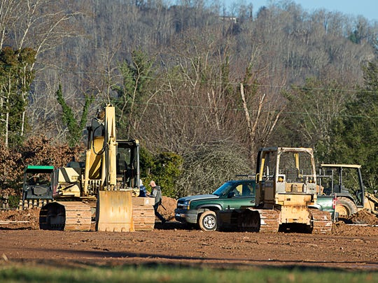Construction continues along Long Shoals Road Thursday Dec. 3.