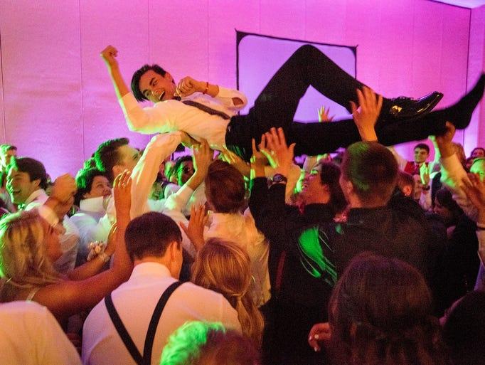 Dalton James surfs the dance floor during the Grace