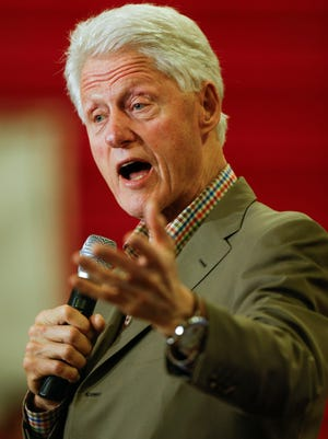 Former Pres. Bill Clinton delivers a speech at the Prestonsburg Elementary School in eastern Kentucky on Thursday evening as he looks to build support for his wife, Hillary Clinton, in coal country. May 12, 2016