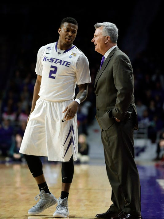 FILE- In this Feb. 14, 2015, file photo, Kansas State guard Marcus Foster and coach Bruce Weber talk during the second half of an NCAA college basketball game against Oklahoma at Bramlage Coliseum in Manhattan, Kan. Creighton coach Greg McDermott's high-risk decision to bring in Foster as a transfer three years ago has been highly rewarding for himself, Foster and the program. (AP Photo/Orlin Wagner, file)