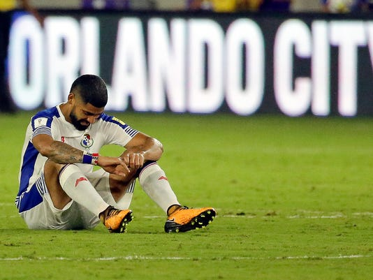 Panama's Gabriel Gomez sits on the field after the team's 4-0 loss to the United States in a World Cup qualifying soccer match, Friday, Oct. 6, 2017, in Orlando, Fla. (AP Photo/John Raoux)