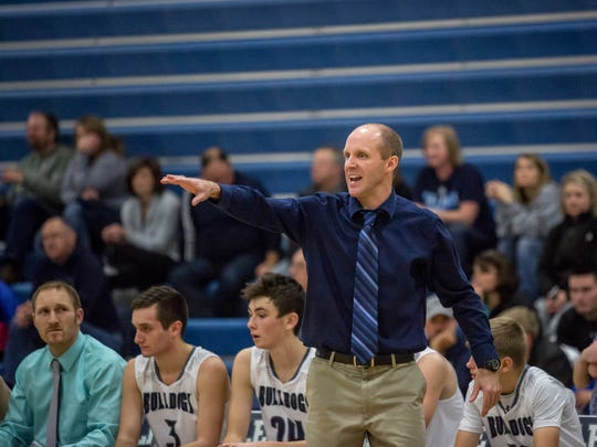 Yale coach Garnett Kohler yells to players from the