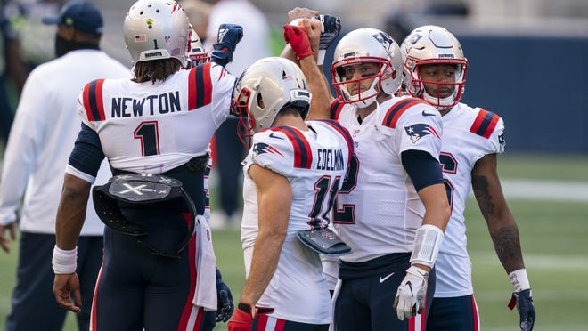 Patriots including quarterback Cam Newton, left, wide receiver Julian Edelman, backup quarterback Brian Hoyer, second from right, and wide receiver Jakobi Meyers huddle before a game against the Seattle Seahawks last month. Hoyer will likely start for the Patriots in Monday night's rescheduled game against the Kansas City Chiefs.