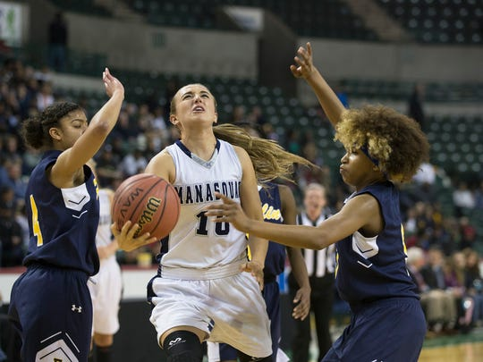 Manasquan's Dara Mabrey drive to the basket between