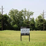 A real estate sign offers a large parcel for sale along Veterans Parkway in Jeffersonville. Recent openings along Veterans Parkway in Jeffersonville include a Krispy Kreme, Culvers as well as a SavAStep and Comfy Cow east of Interstate 65. August 5, 2015