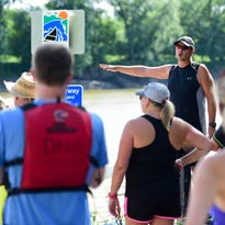 Todd Robertson with the DNR gives  paddlers instructions on water safety June 8 during the DNR and MPO sponsored Greater Des Moines Water Trails and Greenways Plan paddling event.