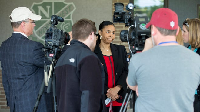 Michelle Brittain-Watts, Principal at Northwest High School, talks with media members about a series of recent fights at the school, including one which was recorded and posted from a smart phone, Indianapolis, Wednesday, May 6, 2015.