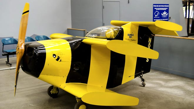 """Robert Starr of Tempe achieved his moment of fame in the Guinness Book of Records with the flight of his little """"Bumble Bee,"""" recognized as the world's smallest biplane."""