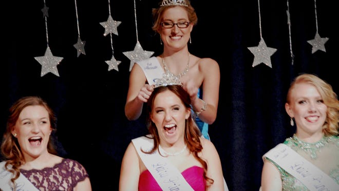 Gina Atsma of Amity, center representing Polk County in the Oregon Dairy Princess-Ambassador program, is crowned First Alternate at the recent 2016 ODPA Coronation Banquet in Salem. Crowning her is the 2015 First Alternate, Megan Sprute. At left is Sara Pierson of St. Paul, and at right is Olivia Miller of Independence.
