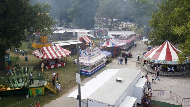 In addition to chicken dinners, the festival includes a carnival, vendors, the Slick Chick pageant, a gospel tent and live bands.