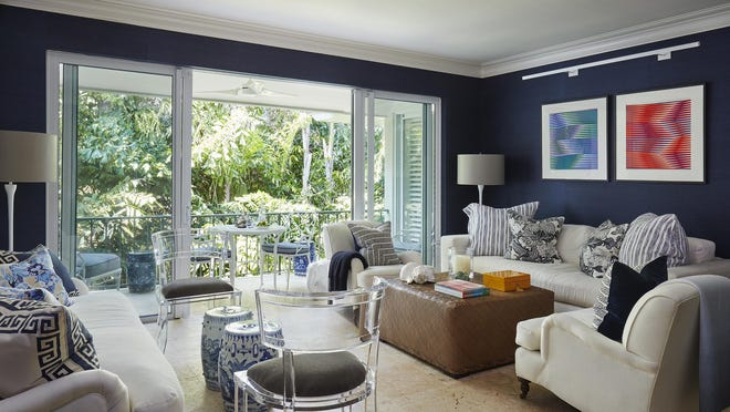 """The living room of Fernando Wong and Tim Johnson's condominium at 320 Chilean Ave. in Palm Beach has treetop views. """"You feel like you are in a treehouse,"""" says Johnson. The condo is listed for sale at $1 million."""