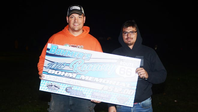 Bohmer's Rt. 66 Raceway promoter, Robby Bohm (left) presents a check to Dustin Heath. In a long, 22-year racing career, Heath was able to claim his first Bohmer's win during the season-ending Bohm Memorial race on Oct. 4.