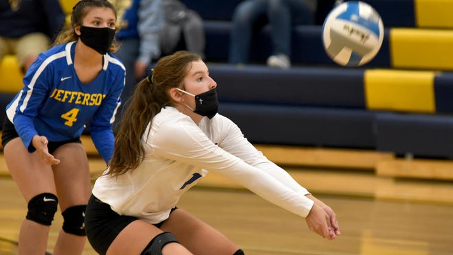 Sydney Masserant of Jefferson passes the ball up with teammate Lily Liptow looking on Tuesday against Erie Mason.