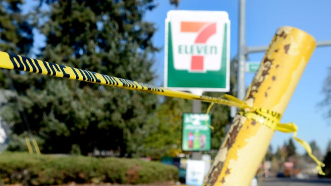 Police tape surounds the 7-Eleven where Linfield College sophomore Parker Moore was fatally stabbed Saturday night. Photographed in McMinnville, Ore., on Sunday, Nov. 16, 2014.