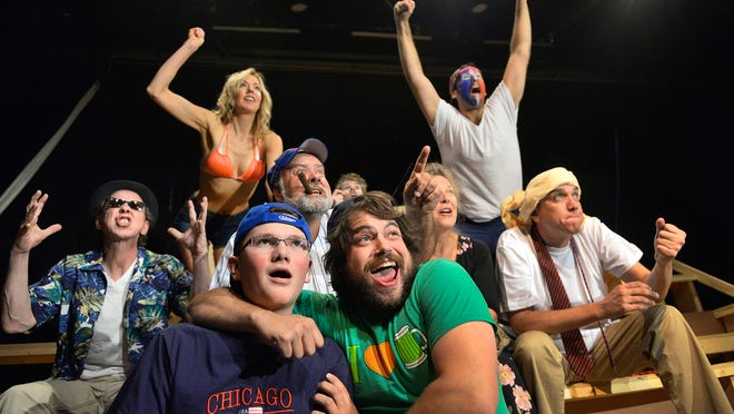 """The cast of """"Bleacher Bums"""" reacts to a play during a Cubs baseball game in the Pioneer Place on Fifth production."""