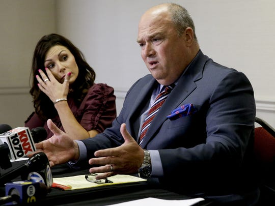 Jamie Dantzscher listens as attorney John Manly speaks during a news conference Thursday, Anaheim, Calif., Thursday, Aug. 17, 2017. Dantzscher and former gymnast Rachael Denhollander have filed civil lawsuits against USA Gymnastics and former team doctor Larry Nassar, claiming they were sexually abused during their careers and want the organization to remove members of the organization's board of directors.