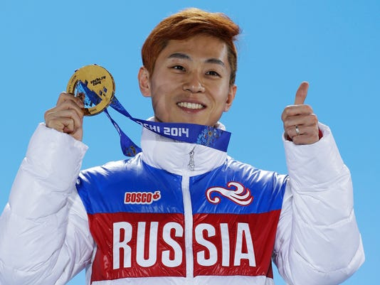 FILE - In this Feb. 15, 2014, file photo, men's 1,000-meter short track speedskating gold medalist Viktor Ahn, of Russia, gestures while holding his medal during the medals ceremony at the Winter Olympics in Sochi, Russia. Six-time Olympic gold medalist Ahn and three former NHL players are among 32 Russian athletes who filed appeals Tuesday, Feb. 6, 2018, seeking spots at the Pyeongchang Olympics.(AP Photo/David J. Phillip, File)