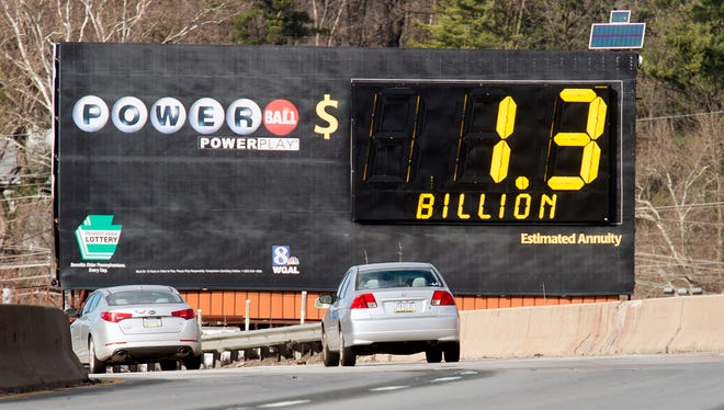 A sign for Powerball lottery shows a $1.3 billion jackpot on Interstate 83 in Springettsbury Township Sunday.