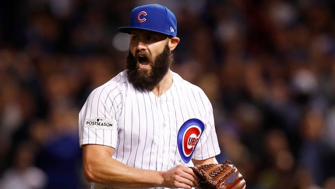 Jake Arrieta reacts after striking out Los Angeles Dodgers outfielder Curtis Granderson.