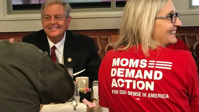 Congressman Ralph Norman put his loaded gun on a Rock Hill Diner table to 'make a point' about guns Friday morning.