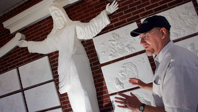 In this 2007 file photo, Bert Baker, an amateur artist, had recently finished a 7-foot-tall sculpture of Christ at Red Bank Baptist Church. The piece, which also depicts multiple scenes from Christ's life, was installed on Easter Sunday. In this 2007 file photo, Bert Baker, an amateur artist, had recently finished a 7-foot-tall sculpture of Christ at Red Bank Baptist Church. The piece, which also depicts multiple scenes from Christ's life, was installed on Easter Sunday.