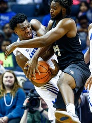 Memphis defender Victor Enoh (left) battles UCF forward