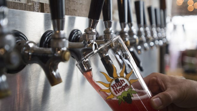 A beer is poured in the tasting room at High Hops Brewery near Windsor Tuesday, June 28, 2016. The brewery, along with the Windsor Gardener, has been annexed into Windsor town limits.