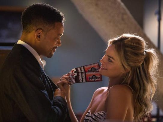 Will Smith, left, as Nicky and Margot Robbie, as Jess,