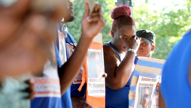 Erica Woods, the mother of QuanDavier Hicks, attended a vigil and march for her son on Saturday. Hicks was shot and killed last June by Cincinnati police.