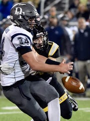 Red Lion's Taylor Uberti, right, forces a fumble by